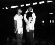 Phog Allen, right, tries to become as tall as KU freshman Wilt Chamberlain in this 1955 file photo.