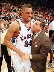 Kansas' Paul Pierce (34) is consoled by Rhode Island coach Jim Harrick after the Rams eliminated the Jayhawks from the 1998 NCAA Tournament. The 1997-98 KU squad went 35-4, tying the school record for most wins in a season.