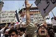 Protesters shout anti-U.S. slogans during a demonstration near the Jama Masjid mosque in New Delhi, India. Muslims around the world are increasingly expressing anger at the U.S. attack on Iraq in radical religious terms.