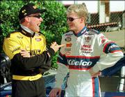 Matt Kenseth, far left, and Dale Earnhardt Jr. share a laugh before a 1999 Grand National series practice.