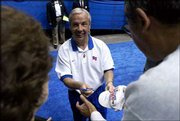 Kansas University coach Roy Williams takes time at the end of the Jayhawks' practice to sign autographs. KU held an open practice Wednesday at the Arrowhead Pond in Anaheim, Calif.