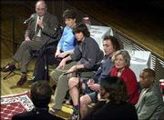 School bond panelists, from top left, Supt. Randy Weseman, Laura Denneler, Caleb Powers, Ed Tato, Judy Wright and James Hilliard discuss issues dealing with the proposed bond issue during a meeting at Liberty Hall. The televised forum Wednesday night was sponsored by The World Company, which owns the Journal-World, Sunflower Broadband and World Online.