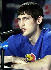 Kansas' Kirk Hinrich answers questions from the media.