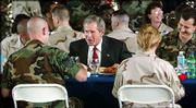 President Bush sits down to lunch with U.S. military personnel at MacDill Air Force Base in Tampa, Fla. Bush spoke at the base Wednesday before heading to Camp David to meet with British Prime Minister Tony Blair.