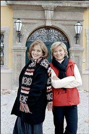 "From left, Angela Cartwright (who played Brigitta von Trapp in ""The Sound of Music"") and Heather Menzies-Urich (Louisa von Trapp) pose in front of the Schloss Frohnburg in Salzburg, Austria, which doubled as the von Trapp family villa in the movie. The Travel Channel is visiting such locations with its series ""Movie Lover&squot;s Road Trip,"" which begins at 8 p.m. April 3 on Sunflower Broadband Channel 71."