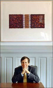 Dana Gioia, new chairman of the National Endowment for the Arts, believes new projects are a good way to overcome the agency's past troubles. He believes poetry should be read out loud and wants to sponsor a national poetry recitation contest, with winners receiving college scholarships. He's pictured at his Washington, D.C., office.