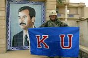 As U.S. forces advanced on the Iraqi capital of Baghdad, fraternity brothers and friends of Capt. Brad Loudon, a 1997 Kansas University graduate, were circulating this photo of Loudon that they found in their email inboxes along with a message from him early Friday morning.