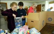 Elizabeth Pirtle, left, along with Cindy Herring, center, and Marilyn Henry, right, pack hygiene products in boxes bound for Afghanistan at Healing Hands International in Nashville, Tenn. The group is preparing a shipment of aid to the war-torn country.