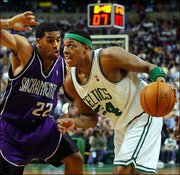 Sacramento's Jim Jackson, left, pressures Boston's Paul Pierce. Pierce scored 40 points, but the Kings edged the Celtics, 93-92, Friday night in Boston.
