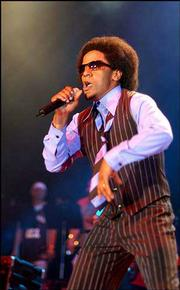 Tego Calderon performs in San Juan, Puerto Rico. Calderon laces salsa and Puerto Rico's bomba rhythms of African ancestry with hip-hop beats to deliver social critics and party songs filled with local lingo and references to old-school acts.