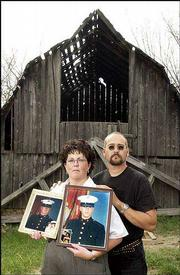 Ivan and Kathy Frye hope their two 20-year-old sons, who are both in the Marines, return safely from the Persian Gulf to the family farm in rural Perry. LCPL Terran Frye, in left photo, is in Iraq. LCPL Justin Frye, in right photo, is on a docked ship in Kuwait. The Fryes are pictured on the farm in September 2002.