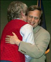 Former Lawrence Mayor Sue Hack congratulates newly-appointed Mayor David Dunfield in April 2003.