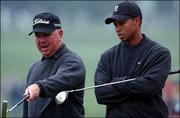 Tiger Woods, right, listens to Mark O'Meara on the 7th hole at the Augusta National Golf Club. The two played a practice round Tuesday to prepare for the 2003 Masters, which begins Thursday in Augusta, Ga.