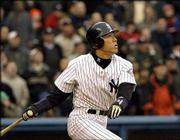 New York's Hideki Matsui watches his grand slam against Minnesota. Matsui became the first Yankee to hit a slam in his first game at Yankee Stadium, and New York defeated the Twins, 7-3, Tuesday.