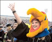 Kelsey Osbourn shows her Jayhawk pride during graduation ceremonies last May.