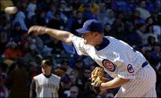 Chicago's Kerry Wood delivers against Pittsburgh. Wood struck out 13 batters in eight innings, and the Cubs blanked the Pirates, 4-0, Saturday in Chicago.