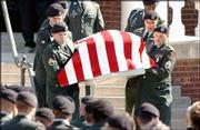 Fort Riley soldiers carry the casket of Sgt. Jake Butler, who was killed April 1 in the war in Iraq. Funeral services were Monday at Wellsville Baptist Church. Wellsville businesses closed in honor of the services for the slain soldier.