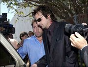 Rock drummer Tommy Lee leaves Santa Monica Superior Court after the verdict was read in the wrongful death lawsuit against him in the drowning of a 4-year-old boy at his home. The jury rejected the wrongful-death claim against Lee.