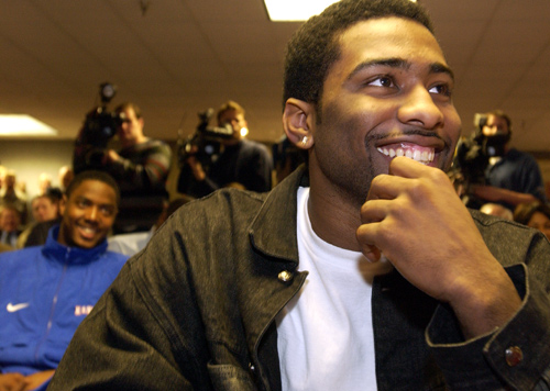 KU sophomores Keith Langford, foreground, and Aaron Miles, background left, laugh at a comment by new men&#39;s basketball coach Bill Self during a news conference. Self, the former University of Illinois head coach, was announced as the new KU head coach Monday in Hadl Auditorium.