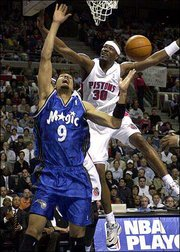 Detroit's Clifford Robinson (30) blocks the shot of Orlando's Drew Gooden. Gooden, a former Kansas University standout, only scored four points in an 89-77 loss to the Pistons Wednesday in Auburn Hills, Mich.