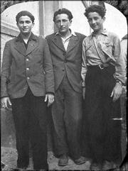 Lou Frydman pictured at right, is shown after his liberation at age 15 in this photograph taken in 1946 in Heidelberg, Germany, along with his older brother Abraham, left, and friend Moniek Wolman, center.