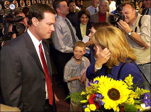 Kansas University men's basketball coach Bill Self, left, speaks to his wife, Cindy, at Hadl Auditorium following last Monday's news conference to introduce him. Self was hired after a weeklong search by the KU athletic department.