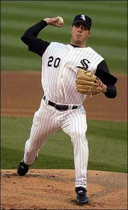 Chicago's Jon Garland delivers against Minnesota. Garland was thrown out of Saturday's game after hitting the Twins' Doug Mientkiewicz with a pitch. The White Sox defeated the Twins, 7-4, in Chicago.