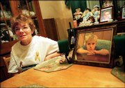 "Donna Myers, the great-aunt of Tristen ""Buddy"" Myers, is shown with a photo of the boy taken shortly before his Oct. 5, 2000, disappearance from their rural Sampson County, N.C., home. Police in Evanston, Ill., have located a 6-year old boy who is believed to be Buddy."