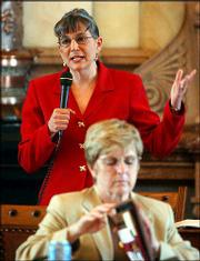 Sen. Susan Wagle, R-Wichita, discusses Dennis Dailey's sex class on the Senate floor Friday at the Statehouse in Topeka.