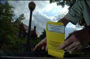 The city of Lawrence is cracking down on unpaid parking tickets, which have led to jail time for some drivers.