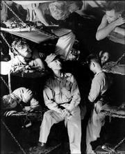 "AMERICAN WAR CORRESPONDENT Ernie Pyle, center, talks with Marines below decks on a U.S. Navy transport during World War II in March 1945. Pyle's life and words are the subject of the one-person show, ""Ernie Pyle's War."""