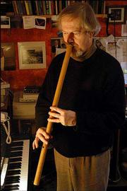 INGRAM MARSHALL PLAYS the gambuh, a Balinese flute, in his home studio in Hamden, Conn. The 60-year-old composer has written enough music to fill at least seven albums and produced numerous concerts.