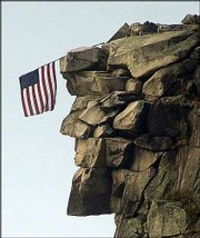 Above is a file photo of the Old Man of the Mountain, a natural stone profile on Cannon Mountain that appears on everything in New Hampshire from road signs to the state quarter. Below is its profile Saturday, when it was discovered the famous formation had collapsed.