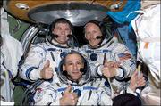 Expedition Six crew members Donald Pettit, front, Kenneth Bowersox, left, and Russian cosmonaut Nikolai Budarin pose for a crew photo on the International Space Station. In a historic first for NASA, a Russian capsule carrying Pettit, Bowersox and Budarin, who spent nearly half a year aboard the international space station, landed early today in the remote steppes of Central Asia.