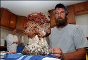 Vernon Richards, of rural Ottawa, was spooked while hunting morel mushrooms on his land when he turned and saw this 13-inch-tall, 7-pound false morel growing at the base of a red oak. Richards is now keeping the fungus in his freezer.