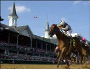 Funny Cide, with jockey Jose Santos, drives to win the Kentucky Derby. Santos rode Funny Cide, a gelding, to the victory Saturday at Churchill Downs in Louisville, Ky.