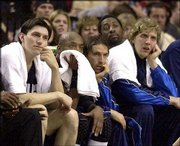 Dallas players, from left, Eduardo Najera, Nick Van Exel, Steve Nash and Dirk Nowitzki watch as the Mavericks lose Game 4 of their first-round series to the Trail Blazers in Portland, Ore. Dallas is on the brink of making history: becoming the first NBA team to blow a 3-0 lead in the playoffs.
