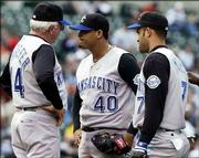 ansas City bench coach Bob Schaefer, left, talks to pitcher Runelvys Hernandez (40) as Hernandez stares at home plate during the seventh inning as Mendy Lopez looks on. The Royals fell to Baltimore, 6-1, Saturday in Baltimore.