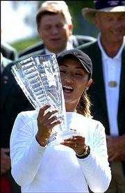 Grace Park celebrates her winning effort at the Michelob Light Open. Park won Sunday by a stroke over Cristie Kerr in Williamsburg, Va.