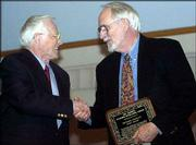 Del Shankel, left, presents Dennis Dailey, professor of social work, with the the Del Shankel Teaching Excellence Award.