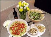 Pictured Clockwise from left, Ziti Pesto with Fresh Roma Tomatoes, Crab Caesar Salad and Christina's Favorite Partito Bruschetta. Food columnist Christina DiGiacomo cooked up this meal last week for a dinner party.