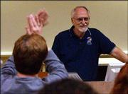 Kansas University professor Dennis Dailey receives a standing ovation during his last class of the semester. Dailey told students Wednesday he hoped the controversy surrounding the course had not inhibited their learning experience.