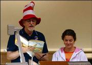 "Professor Dennis Dailey dons a Dr. Seuss hat and reads from ""Oh, The Places You&squot;ll Go,""on the last day of this semester&squot;s human sexuality class. Dailey&squot;s graduate teaching assistant, Teresa Scalise, listens in."