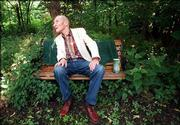 William S. Burroughs enjoys his back yard at his former Lawrence home shortly before his death in August 1997.