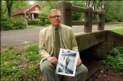 James Grauerholz, longtime companion of William S. Burroughs and executor of the late author's estate, holds a photo of Burroughs near a creek that runs near his former home at 1927 Learnard Ave. Residents of the neighborhood in east Lawrence want the creek to be named after Burroughs.