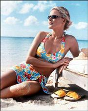 "Liz Claiborne Swimwear&squot;s ""skirtkini"" in a bold floral print combines a brightly colored swimsuit with a functional silhouette, both big trends this summer."
