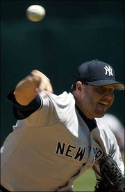 New York's Roger Clemens delivers against Oakland. Clemens claimed his 298th career victory when the Yankees defeated Oakland, 5-2, Saturday in Oakland, Calif.