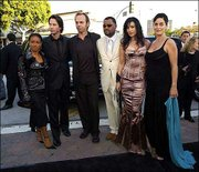 "Cast members of the film ""The Matrix Reloaded,"" from left to right, Jada Pinkett Smith, Keanu Reeves, Hugo Weaving, Laurence Fishburne, Monica Bellucci and Carrie-Anne Moss arrive together to the Los Angeles premiere of the film Wednesday. Movie fans enjoyed film allusions in the first ""Matrix"" ranging from ""High Noon"" to ""Vertigo."""