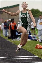 Free State high's Kristen Kearns competes in the triple jump. The Firebirds won the Sunflower League meet Friday in Olathe.