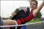Lawrence High's Bobi Riley clears the bar in the high jump. LHS and Free State competed at the Sunflower League track meet Friday in Olathe.